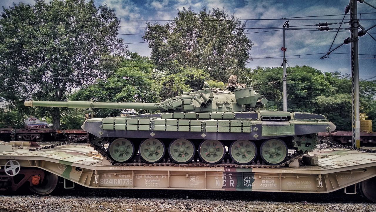 Battle tanks loaded ... Transportation Transportation Tree Stack Railroad Track Cable Rail Transportation Mode Of Transport Land Vehicle Sky Day Electricity Pylon Abundance Power Supply Messy Power Line  Outdoors Parked Army Indian Army Proud Chennai Mobilephotography Large Group Of Objects Railway Track