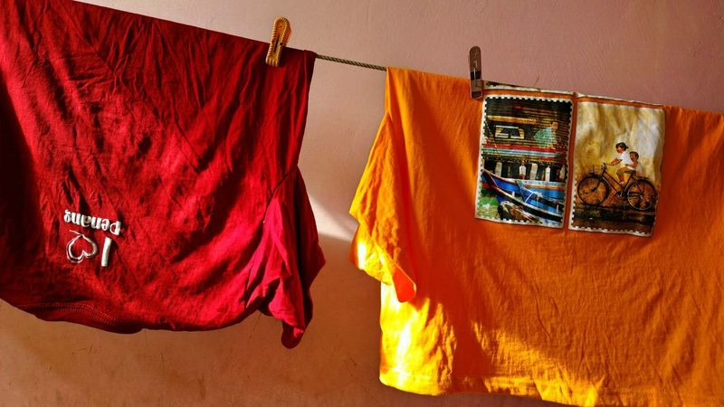 TheFoneFanatic Nokia808 Mobilephotography Abstract India Red Shadows & Lights Yellow Tshirt Clothesline