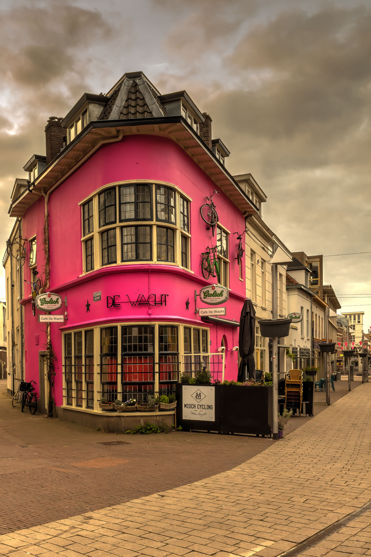 Café De Wacht painted pink to support the Giro d'Italia 2016, starting in Arnhem Architecture Built Structure Cafe City City Life Cloud Cloud - Sky Cloudy Day Exterior Façade Giro D'Italia Giro D'Italia 2016 Multi Colored No People Outdoors Pink Color Sky