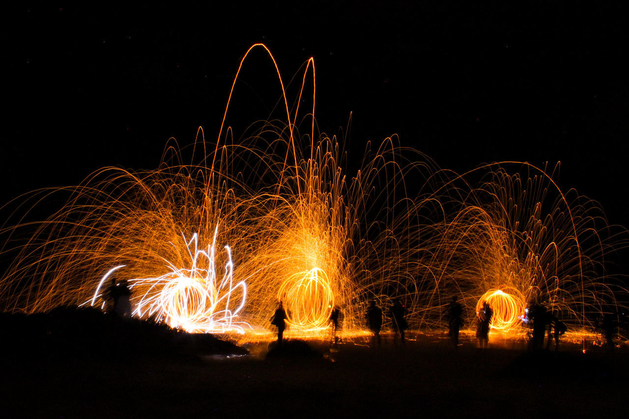 steel wool spinning Exploding Fireworks Illuminated Long Exposure Night Outdoors Silhouette Sparks Steel Wool Steelwool Steelwoolphotography Wire Wool