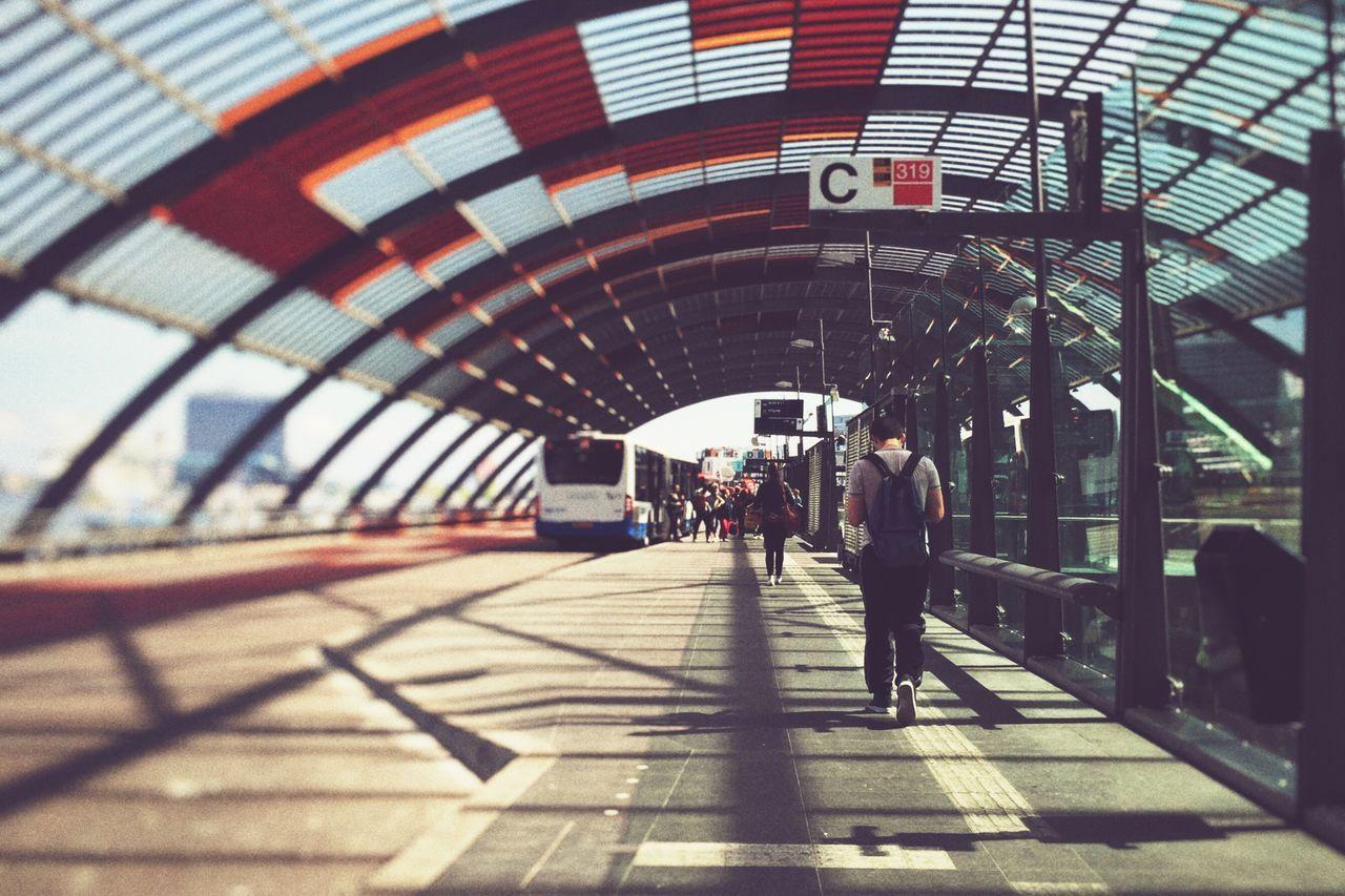 Rear View Full Length Of Man Walking At Amsterdam Centraal Railway Station