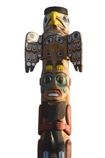 totem pole - north american tribal culture Alaska Art And Craft Canada Carpentry Carving - Craft Product Column Creativity Culture First Nations Isolated Isolated On White Monument Mythology No People Sculpture Statue Totem Totem Pole Traditional Culture Tribal Tribal Art White Background Wood - Material Wooden Wooden Post