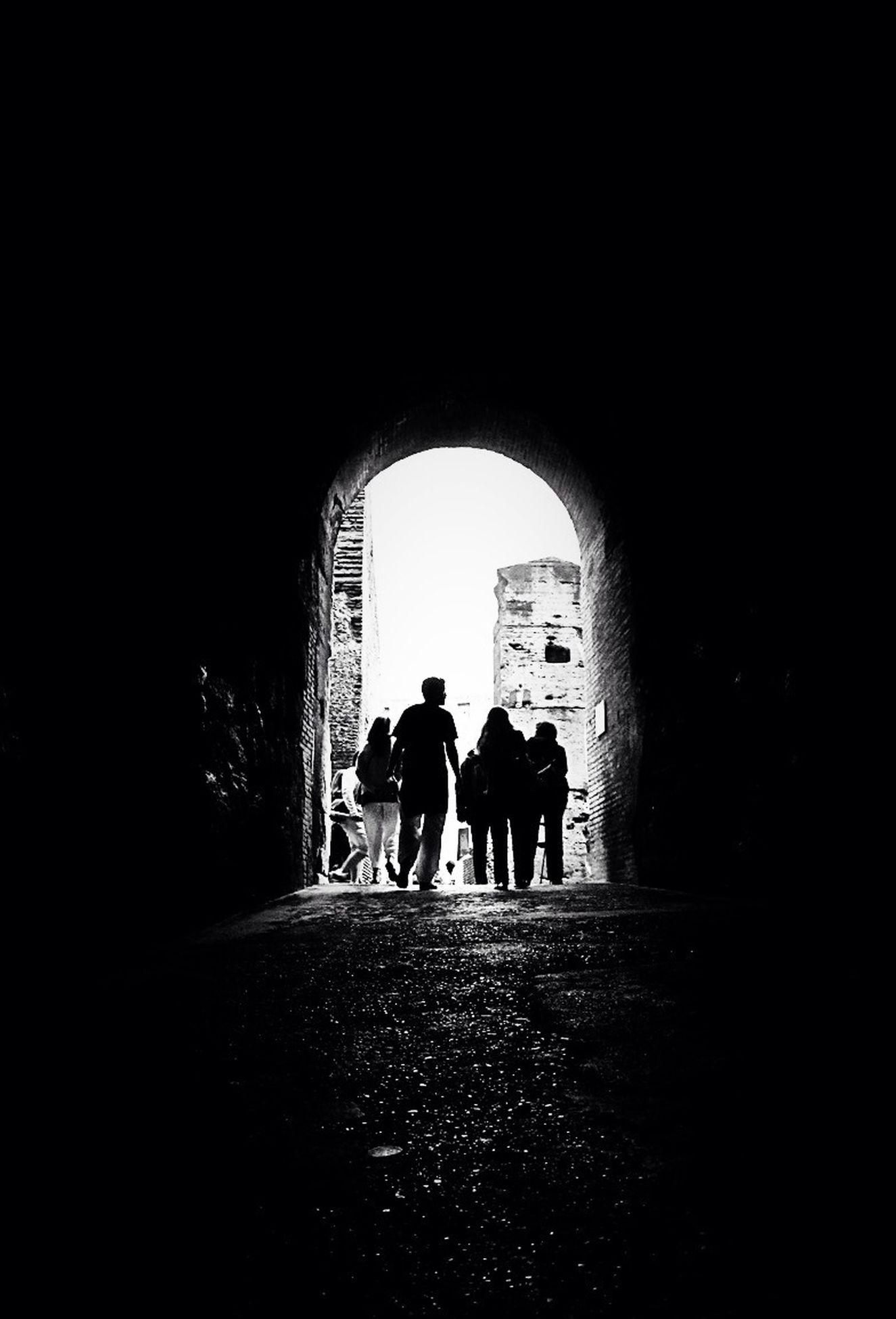 silhouette, indoors, men, full length, arch, lifestyles, togetherness, tunnel, dark, rear view, leisure activity, bonding, walking, standing, person, archway, friendship, love