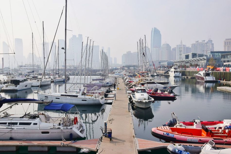 Nautical Vessel Harbor Moored Water Pier Travel Destinations Reflection Sea Sailboat No People Outdoors Tranquility Scenics Commercial Dock Sky Landscape Yacht Day City Cityscape