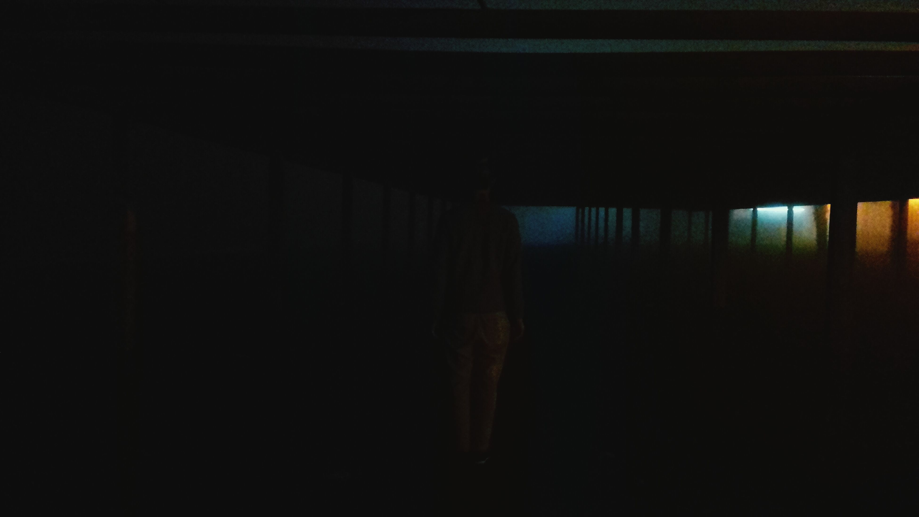 indoors, silhouette, dark, rear view, window, standing, lifestyles, built structure, architecture, men, person, full length, copy space, leisure activity, walking, sunlight, side view, night