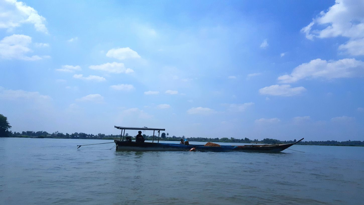 Beauty In Nature Nature Cloud - Sky Water Sky Travel Destinations No People Outdoors Landscape Tourism Nature Beauty In Nature Boat River View River Collection River Nature_collection Laosbeauty Pedal Boat Recreational Boat Floating On Water Clear Sky Laos, Lao Trip Laos