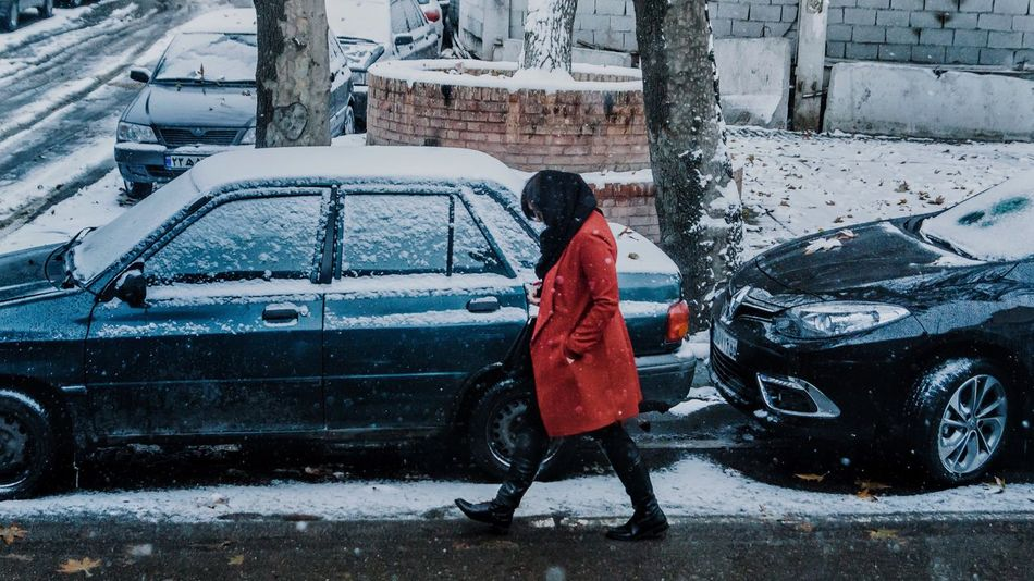 Winter Car Cold Temperature Snow Weather Full Length Transportation Rear View One Person Land Vehicle Warm Clothing Lifestyles Women Snowing Scene Iran Iranian_photography Iranian People Travel Travel Destinations Tranquility Tranquil Scene Walking Red Jacket EyeEmNewHere