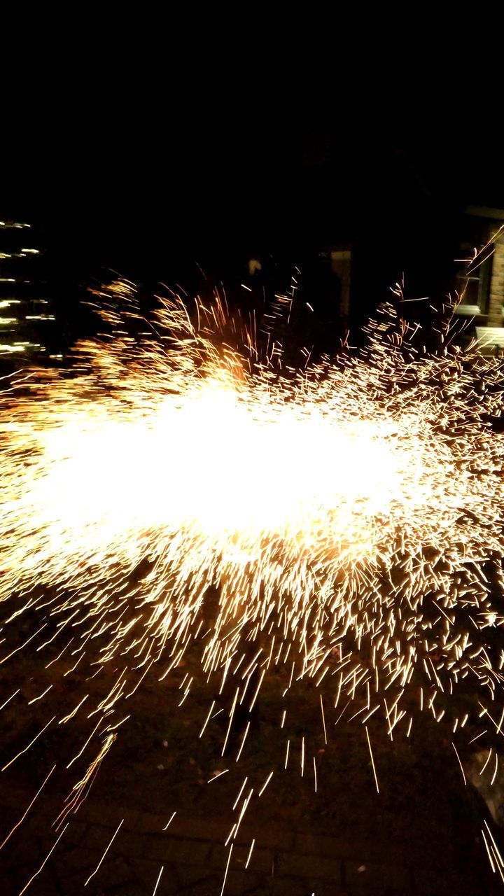night, long exposure, sparks, motion, blurred motion, firework - man made object, glowing, celebration, exploding, firework display, arts culture and entertainment, speed, no people, illuminated, burning, outdoors