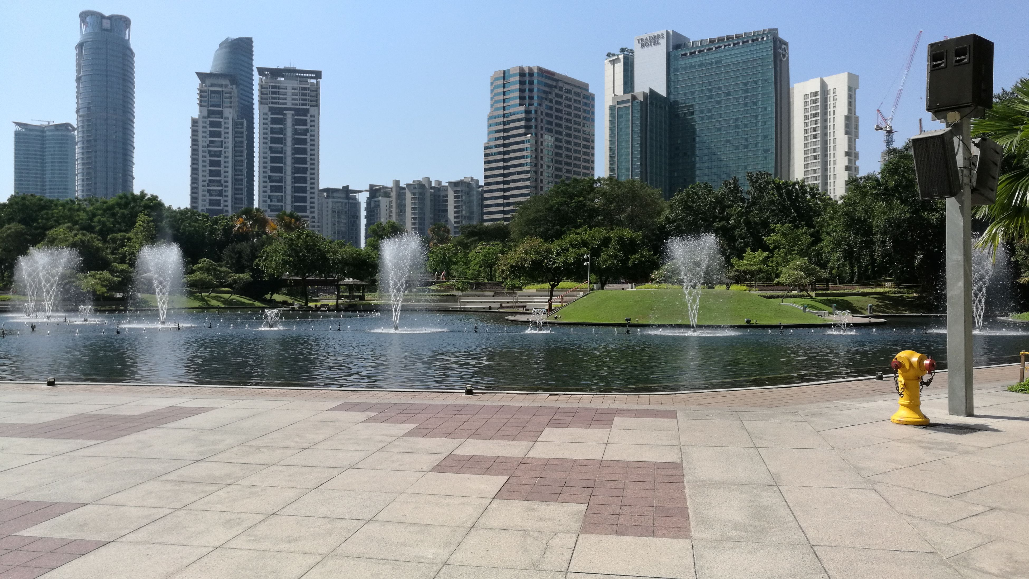 water, fountain, architecture, built structure, city, motion, tree, splashing, skyscraper, spraying, modern, outdoors, cityscape, day, office building, travel destinations, growth, city life, tall - high, flowing water, no people, nature, sky