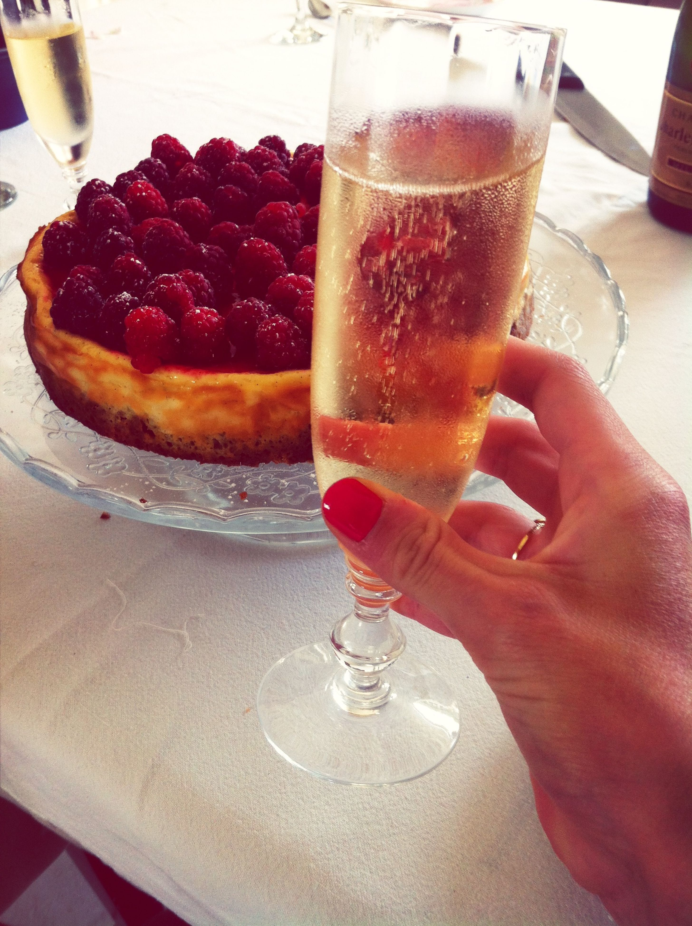 food and drink, drink, freshness, refreshment, drinking glass, food, indoors, table, person, alcohol, indulgence, close-up, drinking straw, strawberry, ready-to-eat, healthy eating, glass - material, holding