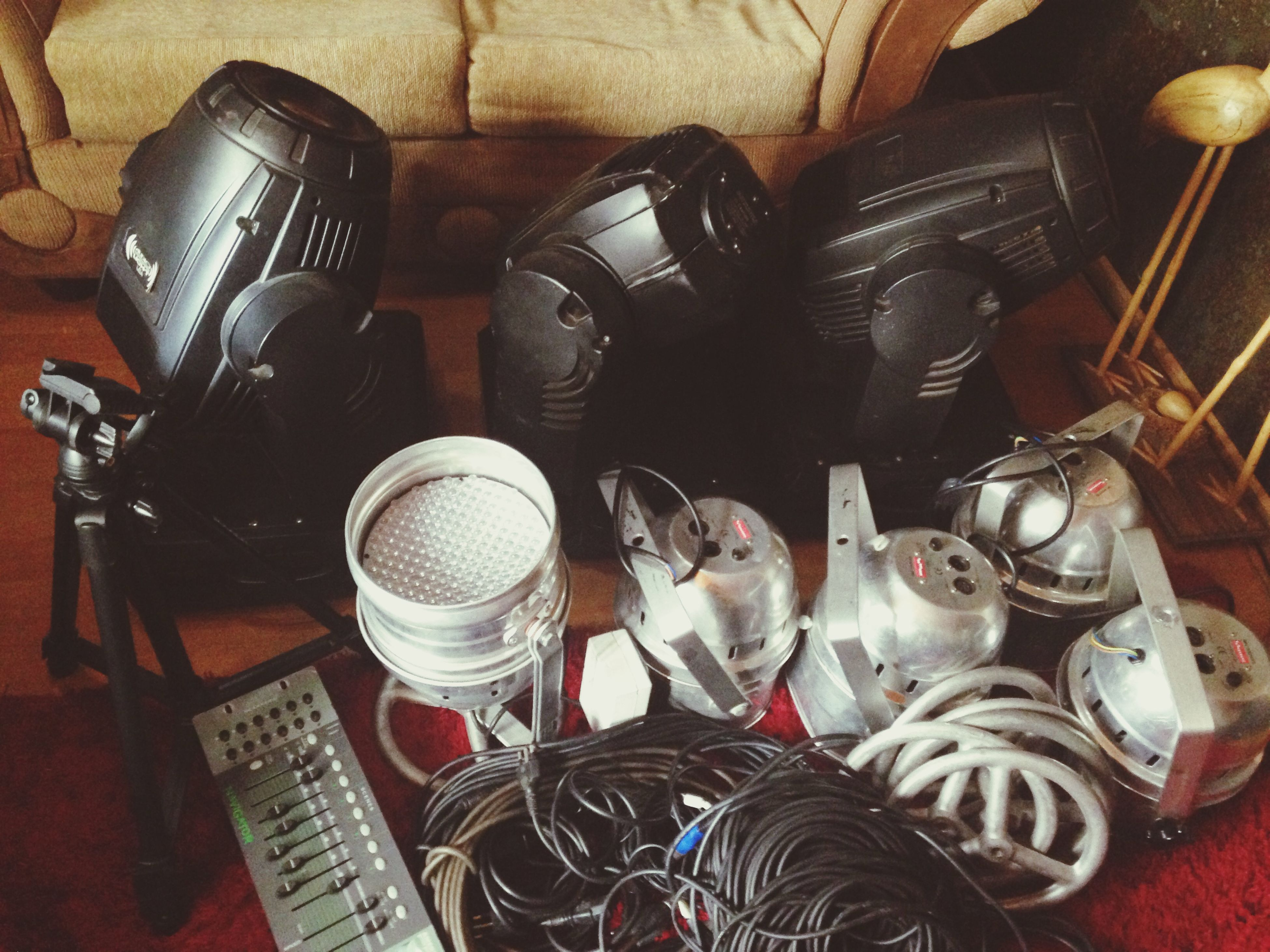 indoors, high angle view, still life, table, technology, bottle, no people, container, machinery, stack, variation, large group of objects, close-up, equipment, food and drink, old-fashioned, industry, work tool, home interior, retro styled