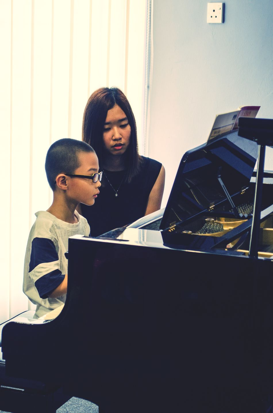 My pianist colleague accompanying her student during a student recital. Piano Moments Asian  Student Teacher Piano Recital Nikon EyeEm Best Shots