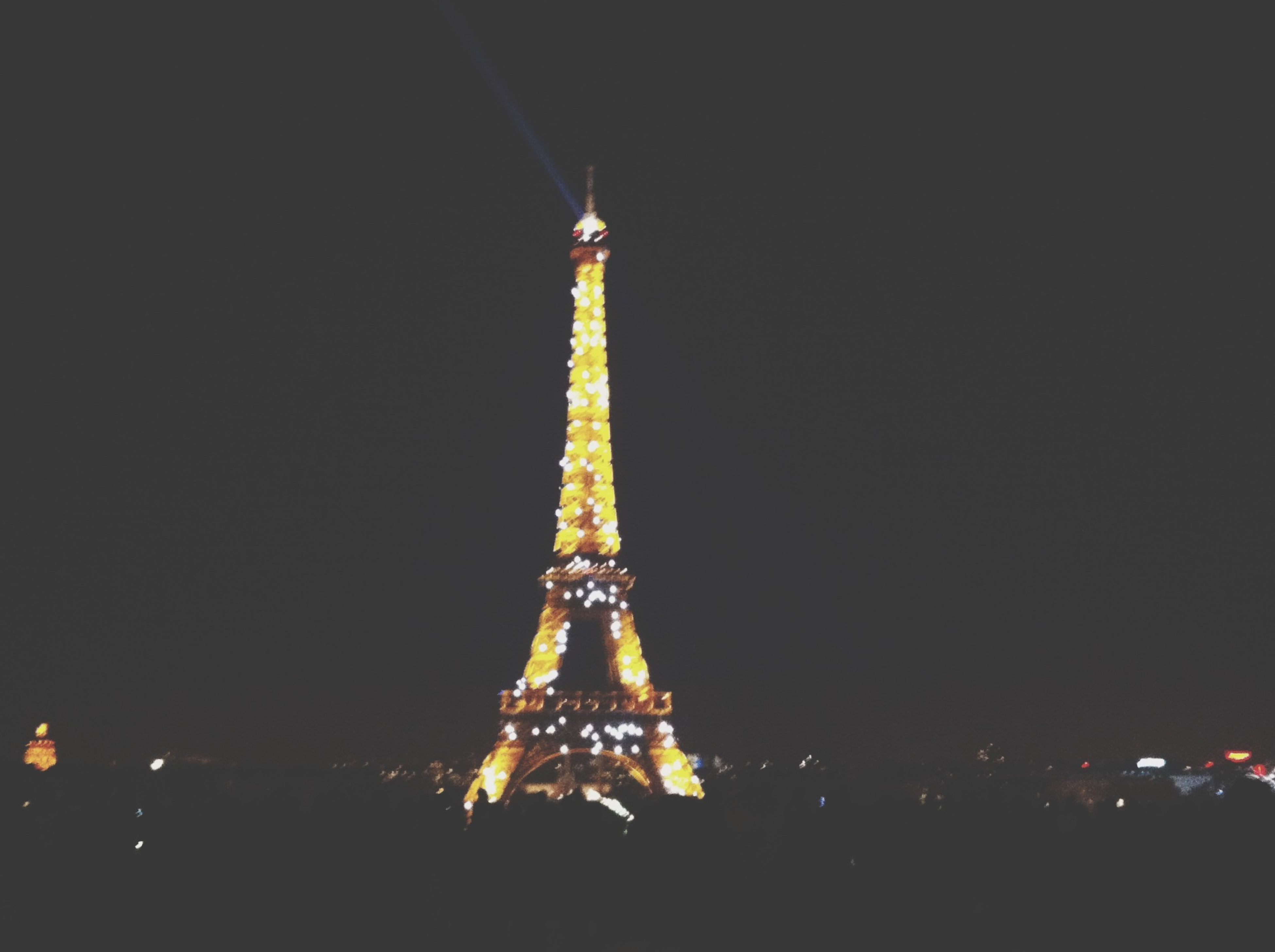 illuminated, night, architecture, built structure, famous place, travel destinations, international landmark, clear sky, copy space, travel, tourism, capital cities, building exterior, eiffel tower, tower, city, sky, tall - high, low angle view, outdoors