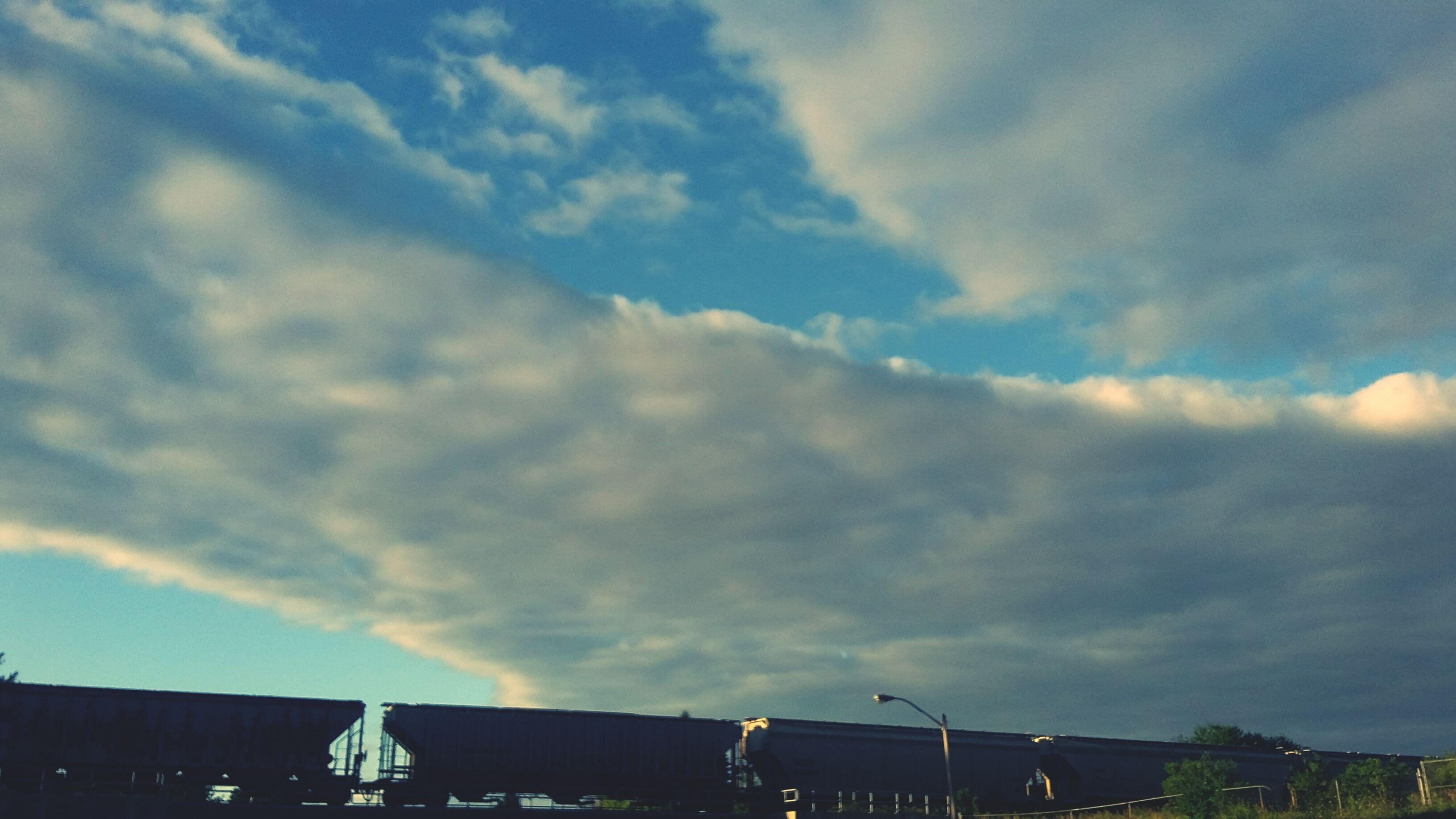 sky, building exterior, cloud - sky, architecture, built structure, cloudy, low angle view, cloud, weather, building, sunset, overcast, city, house, residential structure, residential building, silhouette, nature, outdoors, dusk