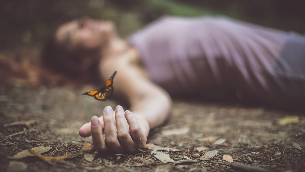 Finally transcendent One Person Real People Outdoors Day Close-up Human Hand Animal Themes Nature Butterfly - Insect Leisure Activity Woman Woman Power Butterfly Laying Down The Portraitist - 2017 EyeEm Awards