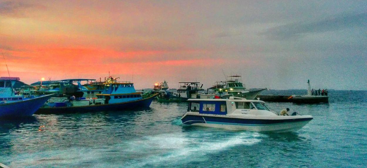 The harbour scene at sunset Sunset Harbour Fishing Boat Speedboat