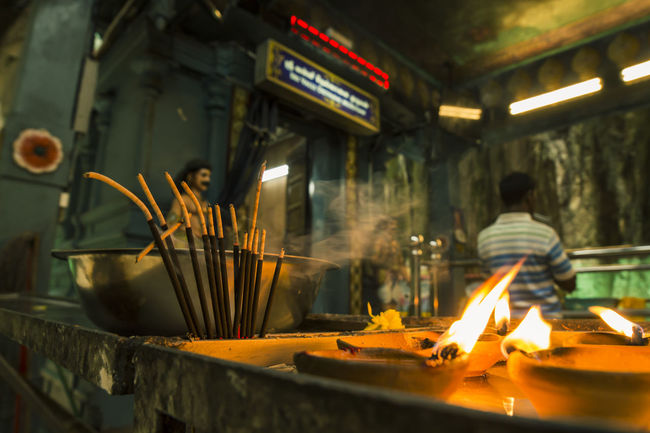 A shot at Batu Caves, Malaysia. Batu Caves -Malaysia Burning Culture Flame Glowing Hindu Hindu Temple Indian Malaysia Smoke - Physical Structure Temple Traditional Traveling