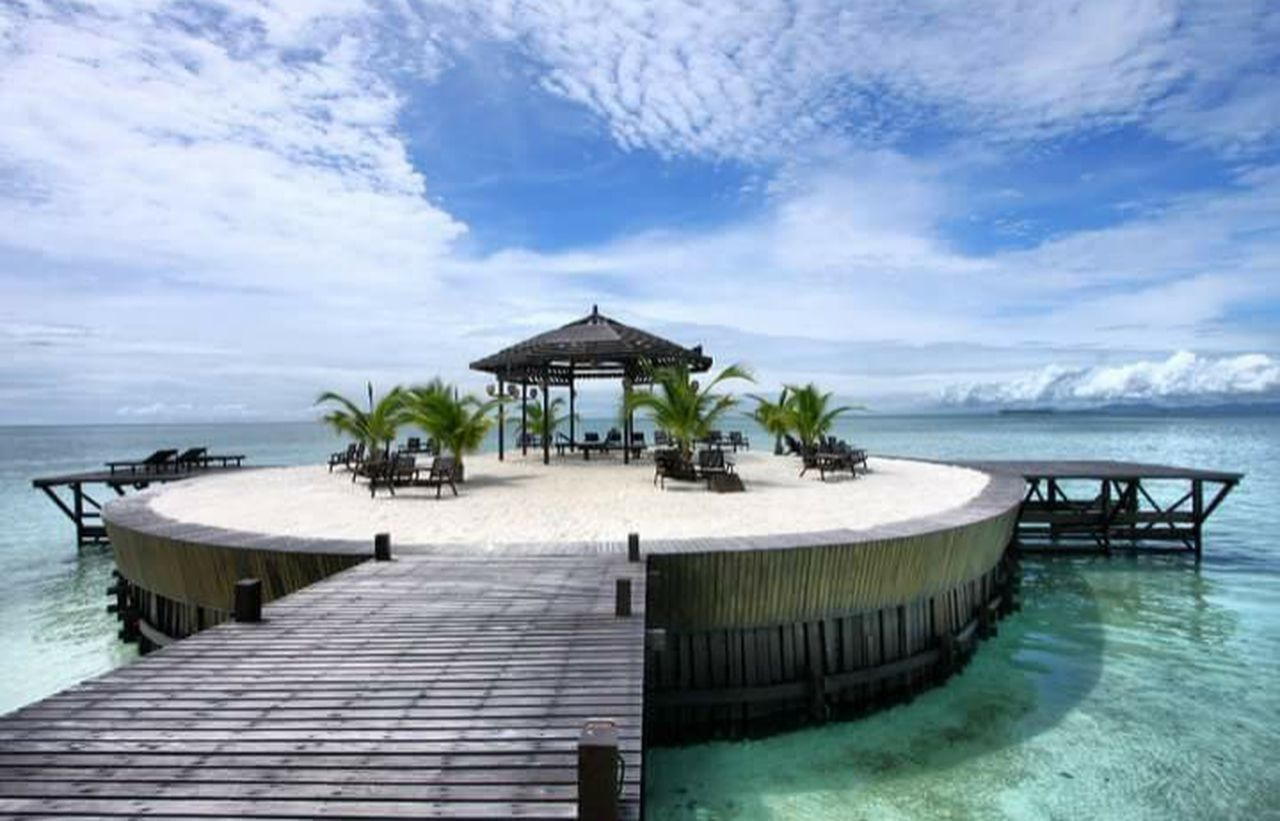 Sea Blue Travel Destinations Water Vacations Travel Beach Architecture Sky Tropical Climate Tourism Outdoors Landscape Cloud - Sky Nature Tranquil Scene Pier No People Scenics Tranquility People Holiday Trip Holiday And Relaxing holiday destination Building Exterior