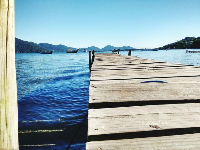 Pequeno deck, Lagoa da Conceição Florianópolis - SC-Brasil Water Sea Mountain Day Beach Outdoors Wood - Material No People Clear Sky Sky Blue Nature Nautical Vessel