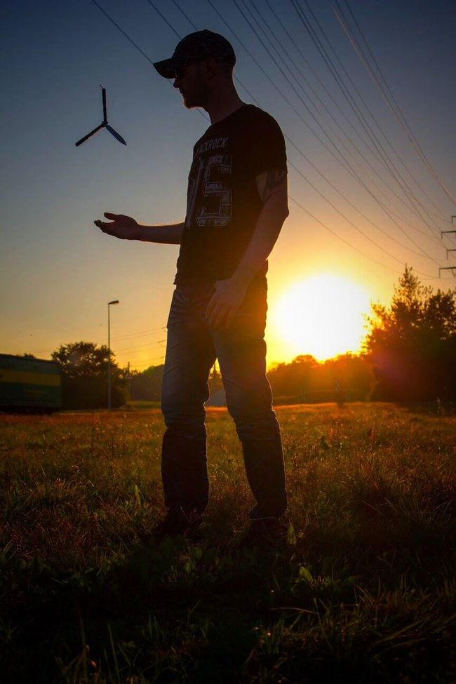 Sunset Lifestyles Sunlight Field Landscape Playing One Man Only Casual Clothing Tranquility Field Man My Love My Man Tadaa Community Silhouette Sun Landscape_photography Canonphotography