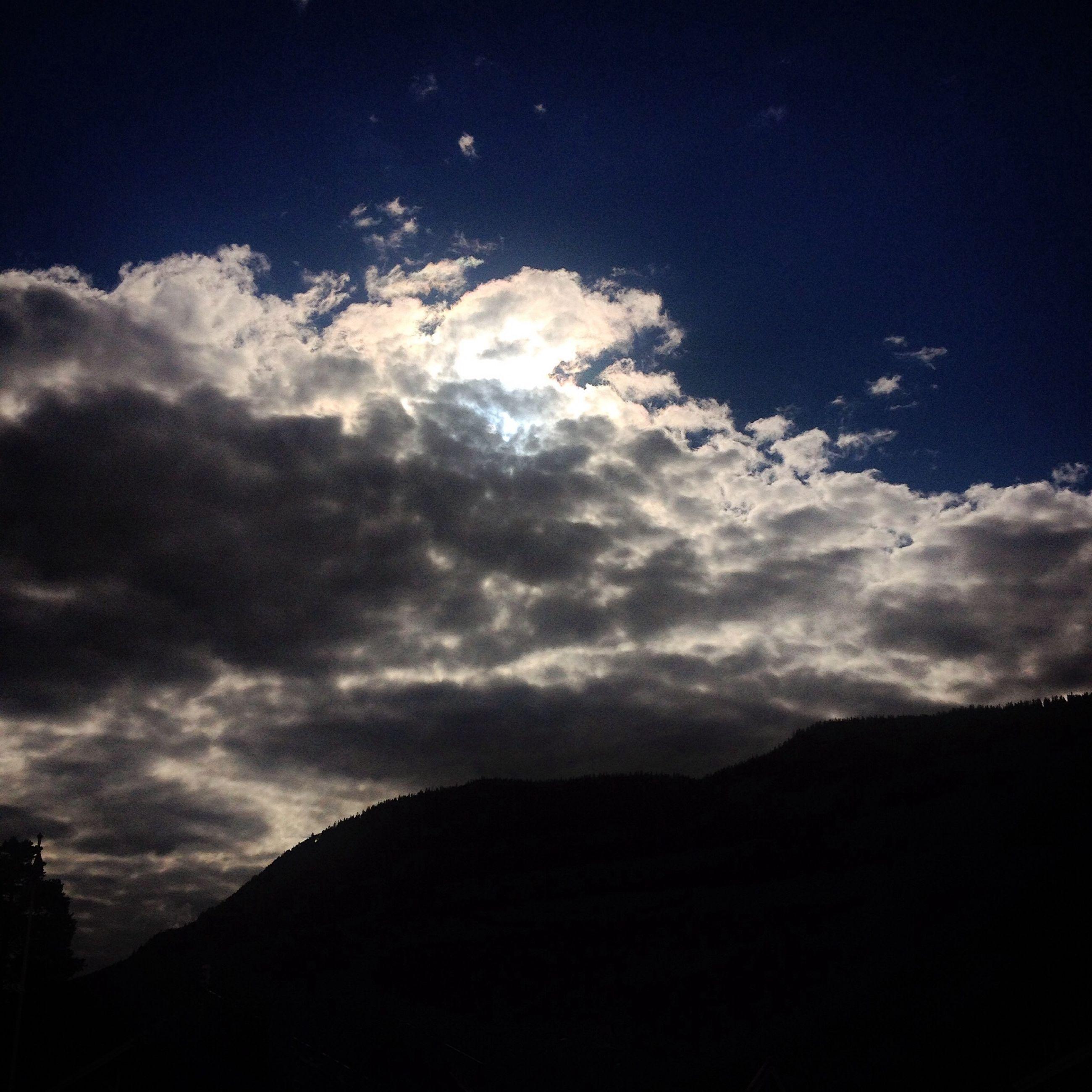 mountain, scenics, sky, tranquil scene, tranquility, beauty in nature, silhouette, cloud - sky, mountain range, nature, cloudy, cloud, landscape, idyllic, majestic, dusk, weather, non-urban scene, outdoors, dark