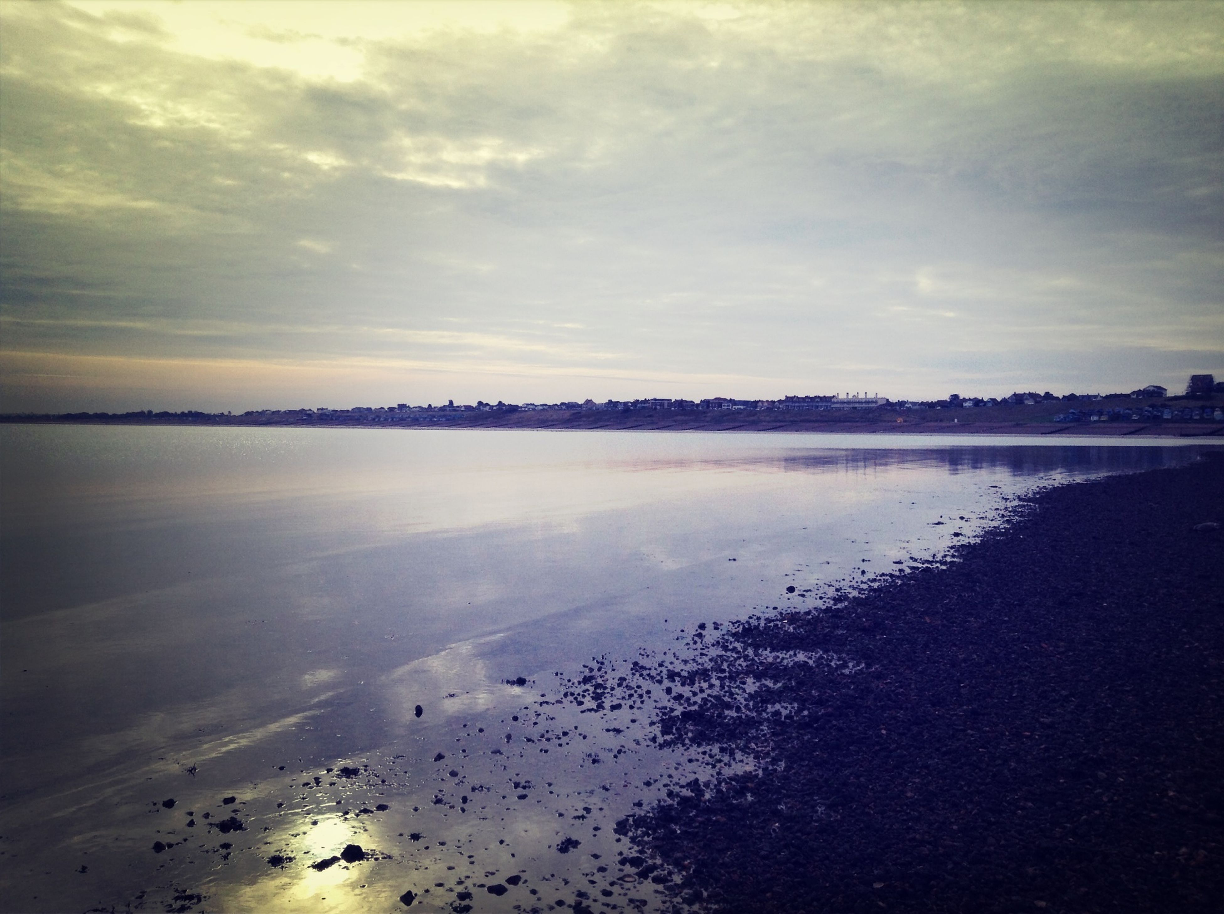 water, sky, tranquil scene, scenics, tranquility, beach, beauty in nature, cloud - sky, sea, shore, nature, reflection, sunset, idyllic, sand, cloudy, cloud, dusk, horizon over water, outdoors