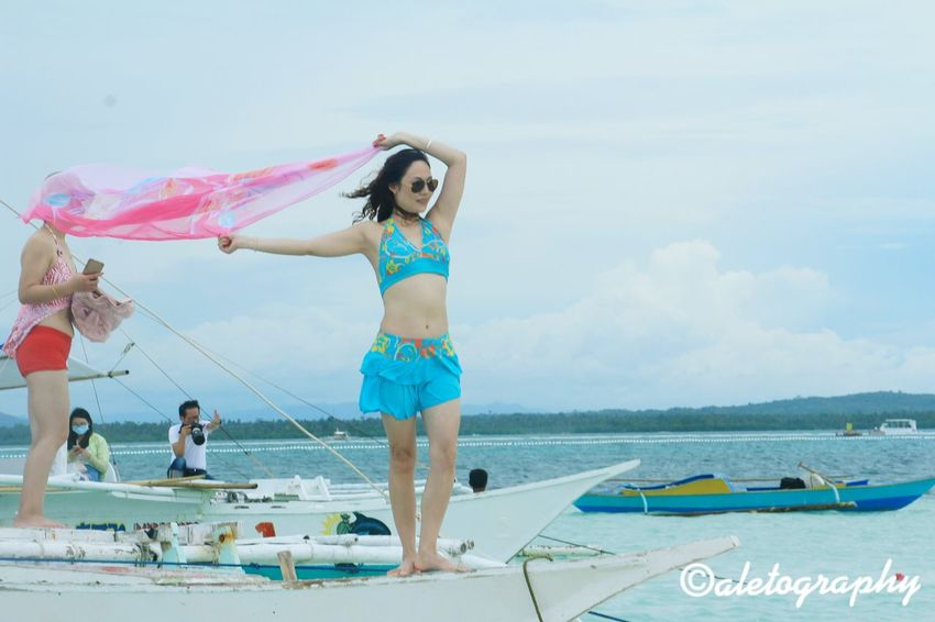 Bohol, Philippines Bohol Philippines Bohol Bohol Island Philippines Full Length Leisure Activity Lifestyles Casual Clothing Person Childhood Arms Outstretched Elementary Age Playful Enjoyment Long Hair Holding Playing Innocence Water Sky Fun Day Carefree Focus On Foreground