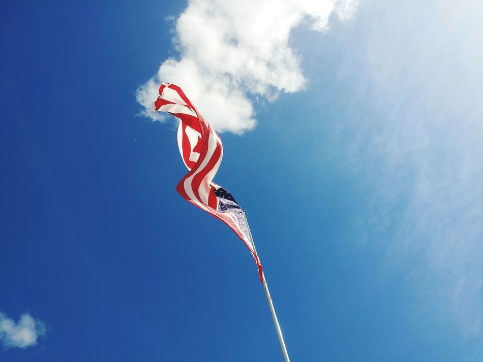 Arts Culture And Entertainment Blue Celebration Low Angle View Sky Red Flying Outdoors Sport Day No People Vapor Trail Nature Airshow flag