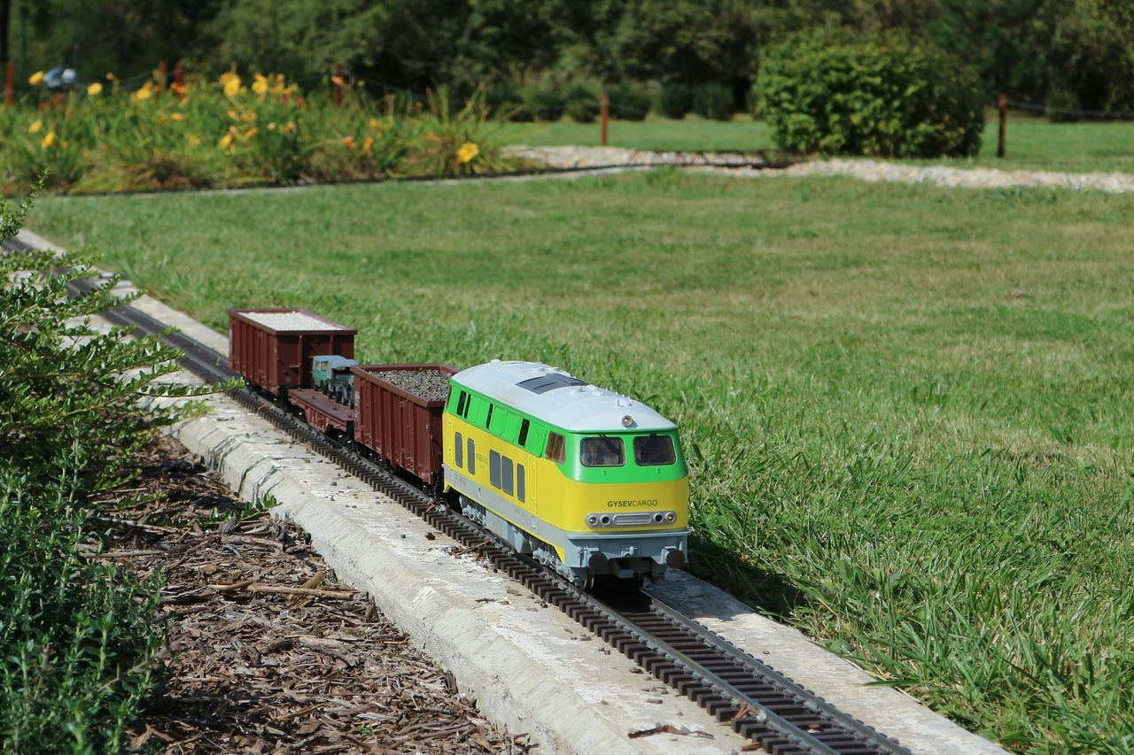 transportation, grass, field, day, railroad track, nature, outdoors, public transportation, green color, no people, landscape