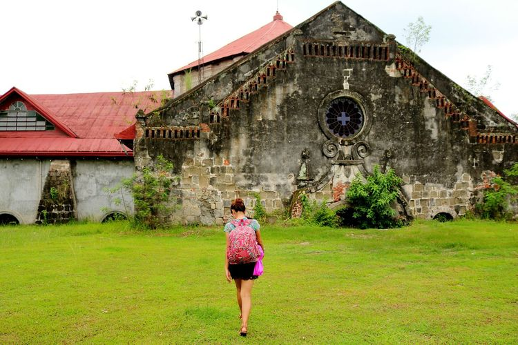 Dont be afraid to trave alone because you get to discover things and places all on your own ❤⛪ Children Only Grass Full Length One Person Childhood Day Rear View Outdoors People Architecture Building Exterior Child One Boy Only Built Structure Real People Sky Adult Philippines Photos The Great Outdoors - 2017 EyeEm Awards Philippines Memorabiliadebacolor Thehalfburiedchurch HistoricalChurch Historical Place Like For Likes
