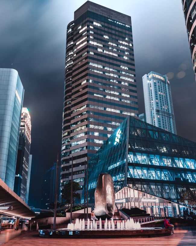 A Normal Evening in Hong Kong Architecture Built Structure Skyscraper Modern City Low Angle View Outdoors Sky Urban Skyline Day EyeEmNewHere The Week On EyeEm Downtown District City Life Modern Travel Destinations