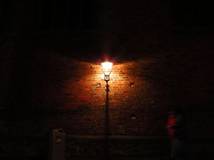 Bricks Capturing Movement Dark Electricity  Illuminated Lamp Lantern Light Lighting Equipment Lübeck Movement Movements Night Night Crawler On The Move Street Street Light Walk