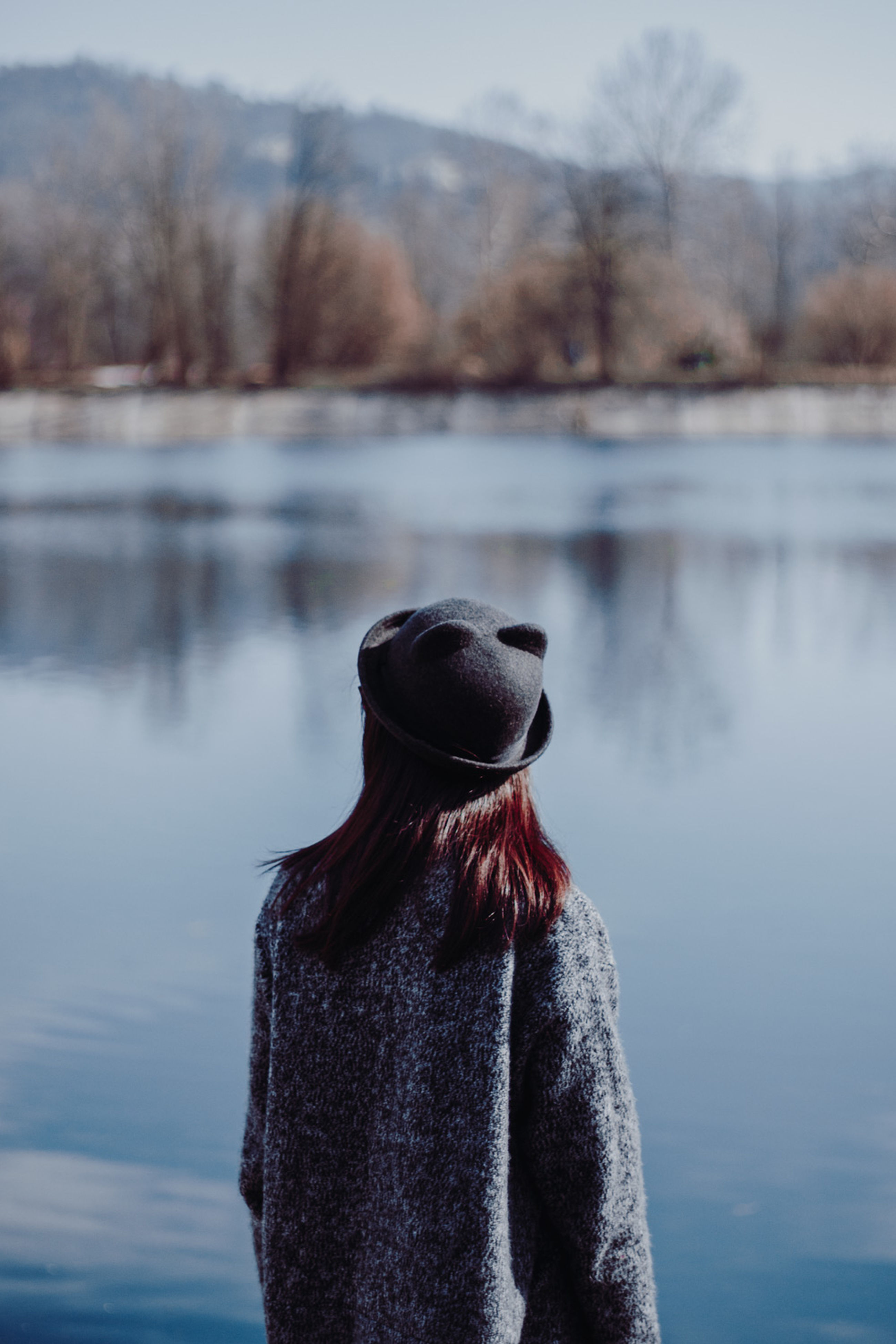 cold temperature, winter, bare tree, real people, lake, warm clothing, one person, snow, water, nature, tree, outdoors, day, people