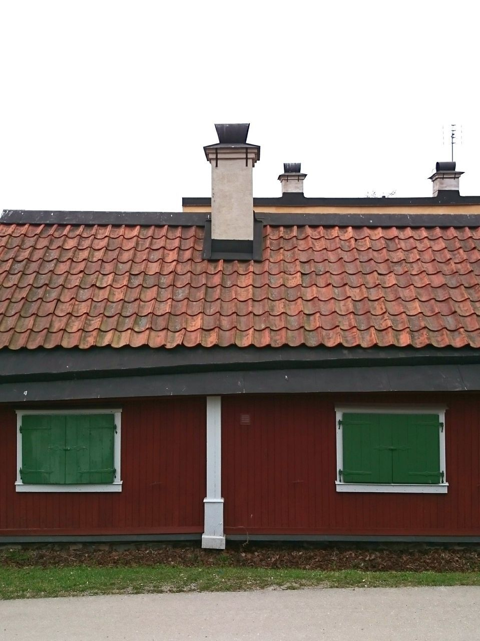 building exterior, architecture, built structure, house, roof, clear sky, outdoors, no people, day, red, tiled roof, sky