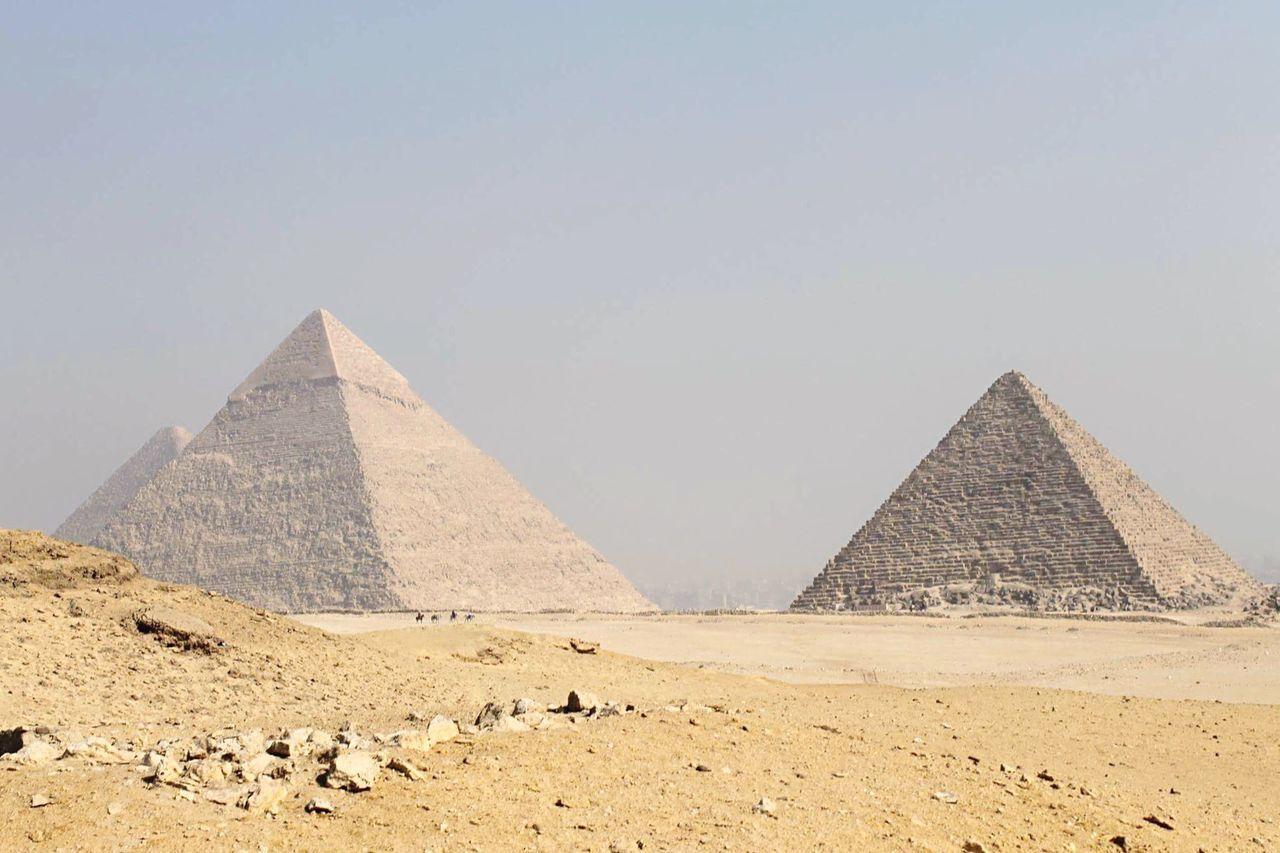 EyeEm Selects Pyramid Ancient travel destinations ancient civilization history geometric shape Archaeology Desert Travel sand EyeEmNewHere Egypt Cairo
