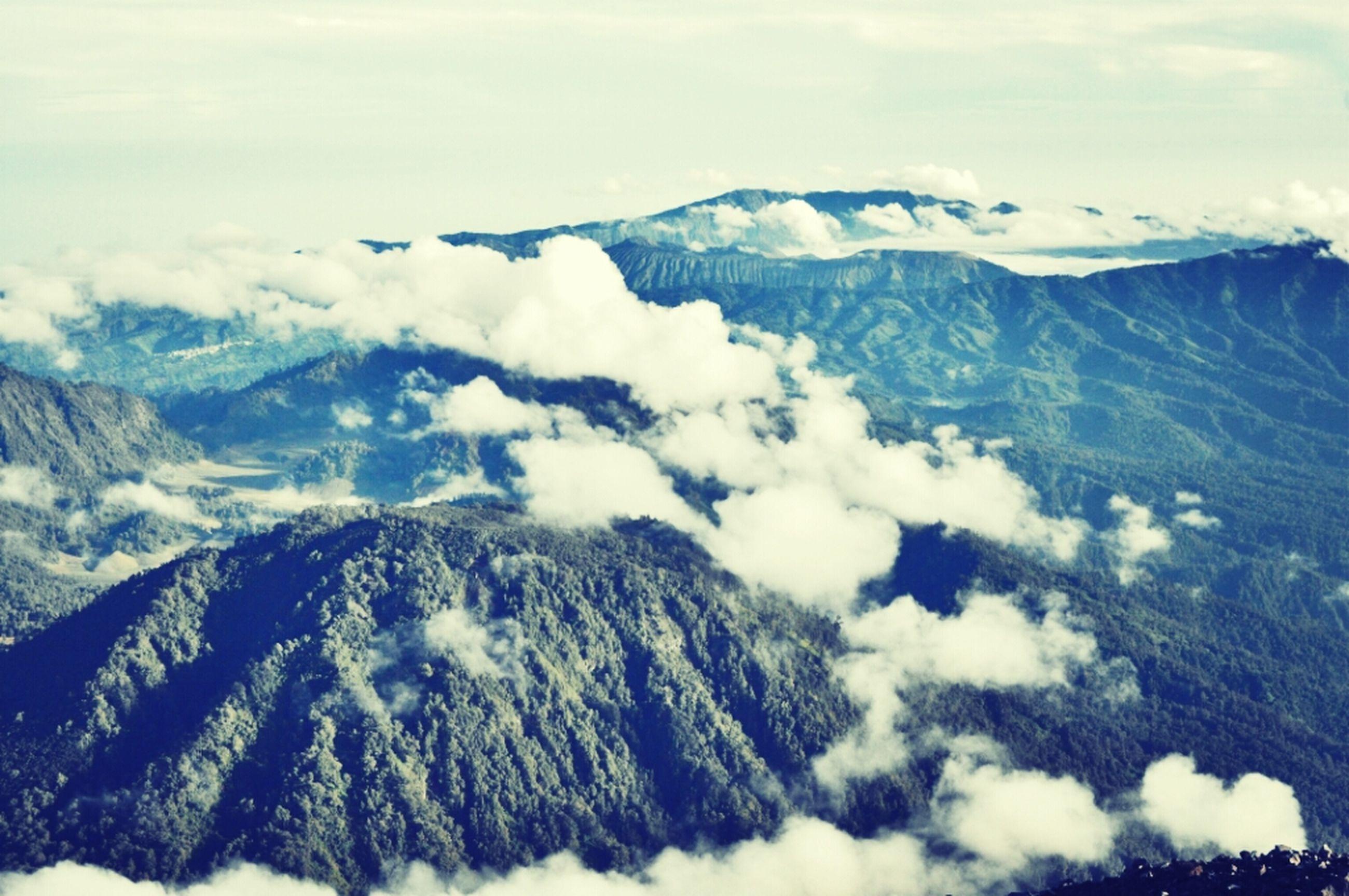 mountain, mountain range, scenics, tranquil scene, tranquility, beauty in nature, snow, landscape, sky, snowcapped mountain, winter, cold temperature, nature, cloud - sky, non-urban scene, majestic, idyllic, cloud, mountain peak, weather