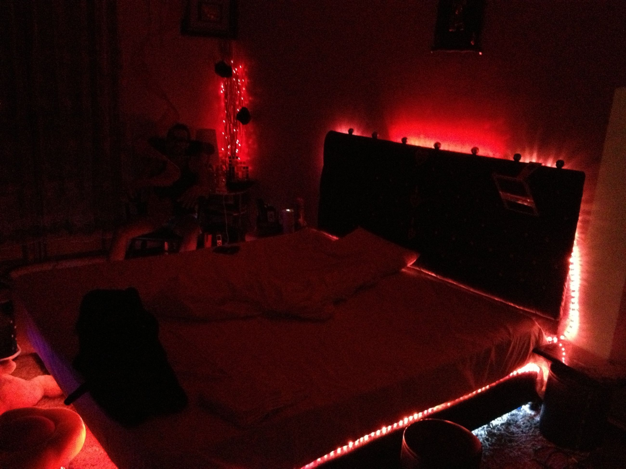 indoors, illuminated, home interior, chair, red, lighting equipment, night, absence, no people, table, house, window, technology, bedroom, domestic room, sofa, interior, room, dark, built structure