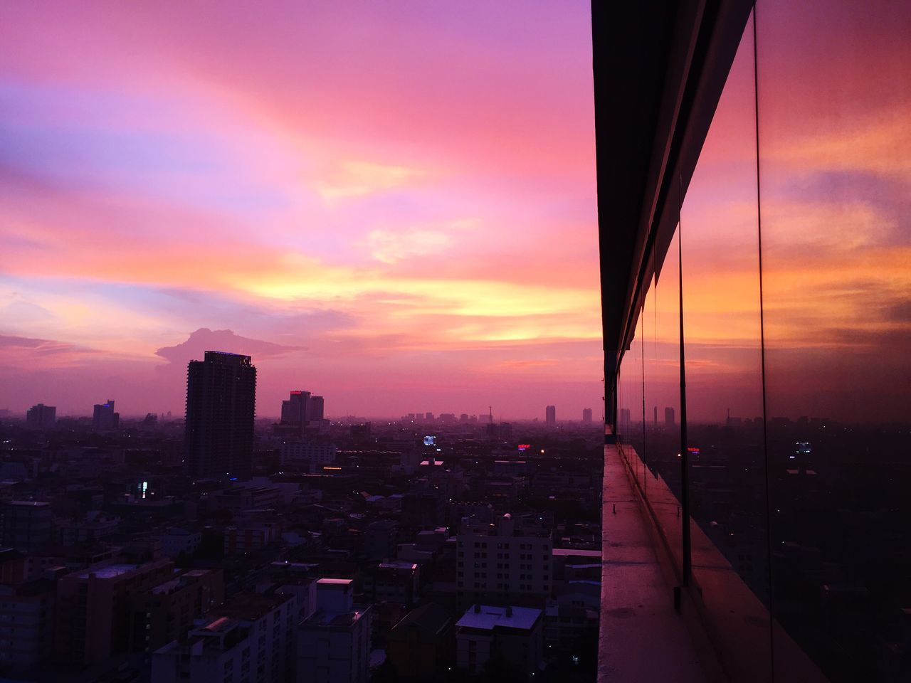 sunset, architecture, building exterior, city, built structure, sky, skyscraper, orange color, cityscape, cloud - sky, no people, city life, outdoors, modern, urban skyline, travel destinations, nature, day