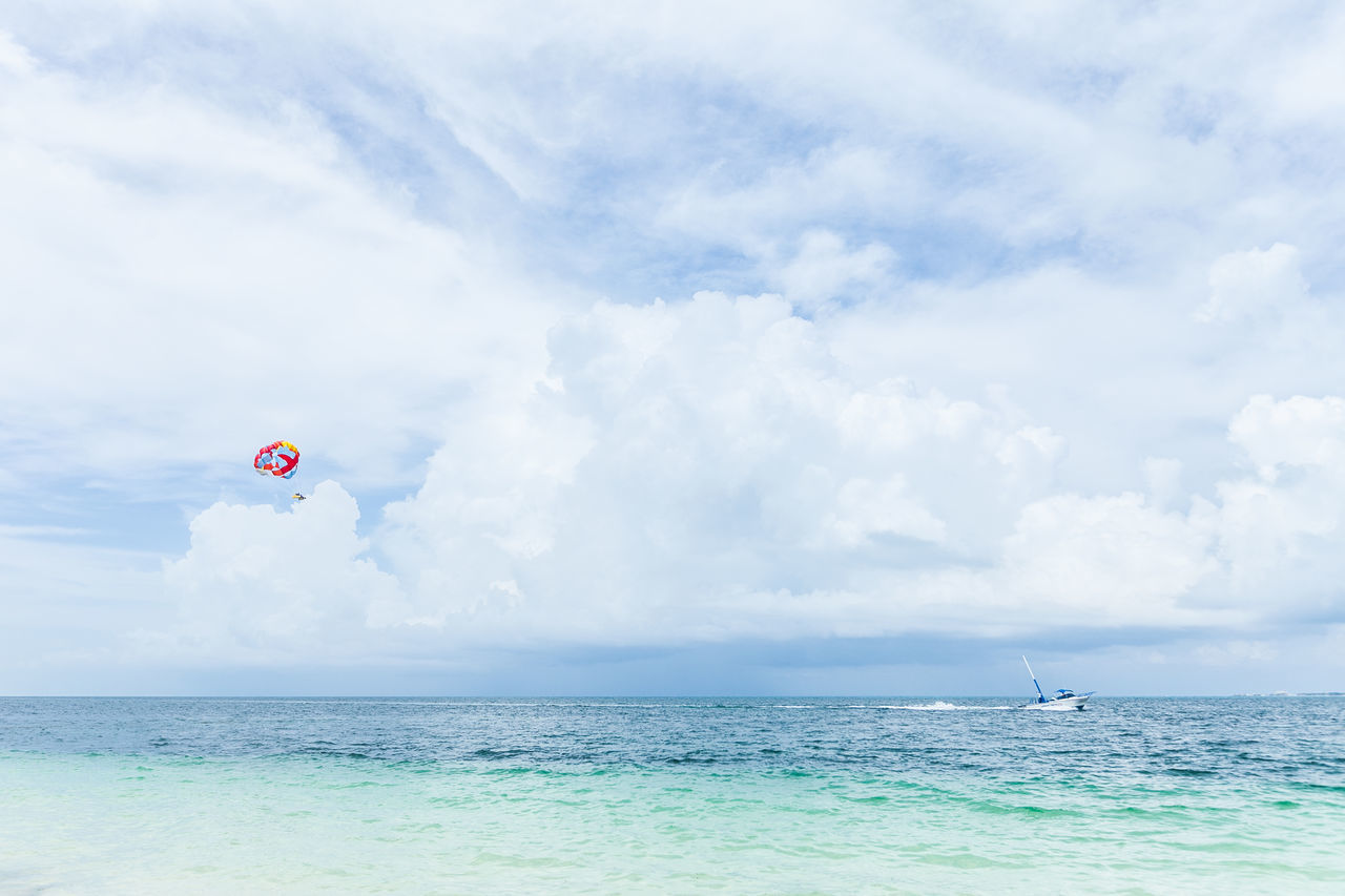 Parasailing in Cancun Adrenaline Cancun Caribbean Cloud Cloud - Sky Cloudy Exciting Fly Flying Flying High Water Sports Leisure Activity Outdoors Parakiting Parasail Parasailing Parascending Recreational  Recreational Outdoor Sky Summer Tranquility Vacations Water Activities Adventure