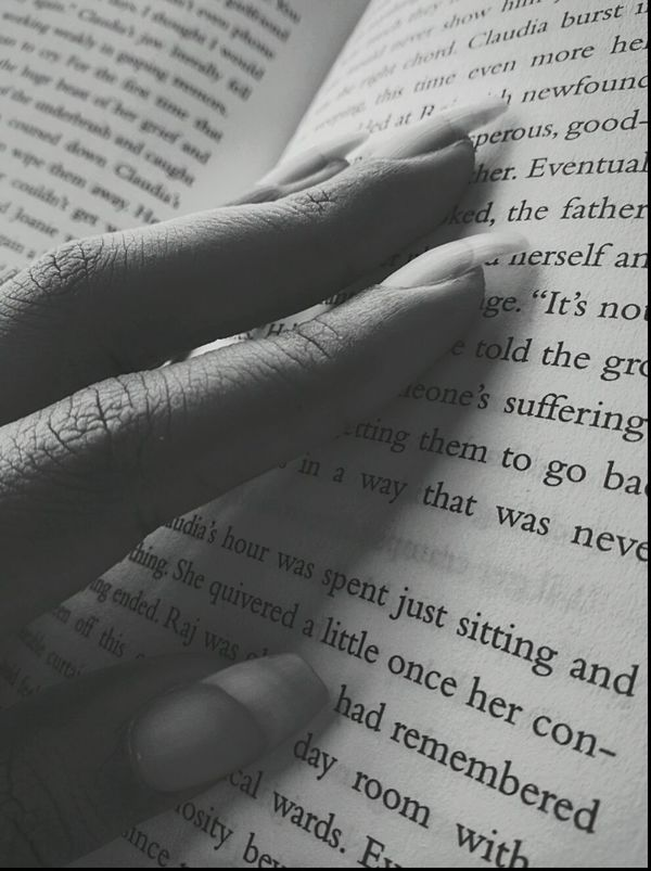 The fingers eagerly lingering to find the best line that describes the soul.Welcome To Black Wisdom Paper Deep Thoughts Deep Text Reading Close-up Fingers Fingers Playing Blackandwhite Photography Indoors  Novel Noveltime Page EyeEm Best Shots EyeEmNewHere EyemEm Best Shots - Black + White