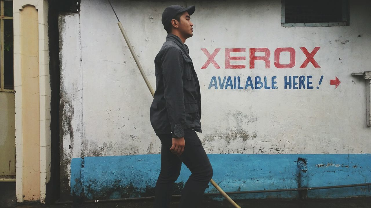 I think he's gonna make copies of himself.Casual Clothing Standing Wall - Building Feature Text Architecture Western Script Built Structure Full Length Person Lifestyles Building Exterior Looking Away Young Adult Mid Adult Leisure Activity Front View Outdoors Day Eyeem Philippines Philippines EyeEm Filipino Photocopy