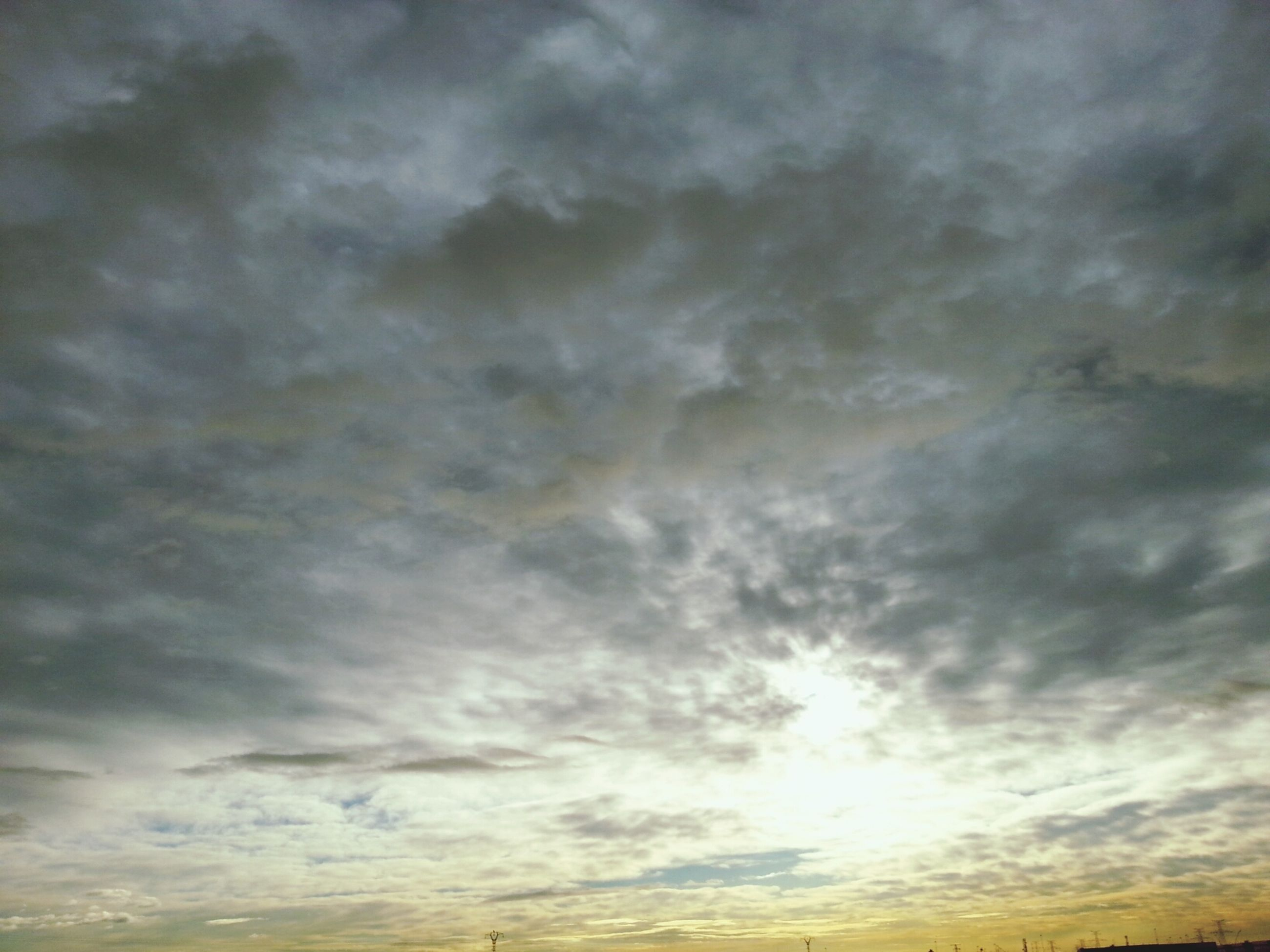 sky, cloud - sky, cloudy, scenics, beauty in nature, tranquility, tranquil scene, low angle view, nature, sunset, cloudscape, weather, overcast, idyllic, cloud, sky only, backgrounds, dramatic sky, outdoors, no people