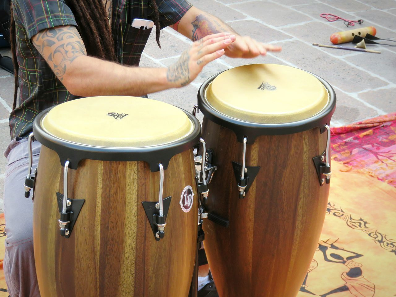 drum - percussion instrument, music, musical instrument, drumstick, drummer, arts culture and entertainment, real people, playing, midsection, musician, human hand, sitting, indoors, men, day