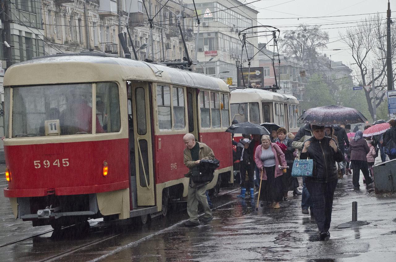 Rainy morning City Large Group Of People Mode Of Transport Public Transportation Rain Tramway Transportation Umbrellas