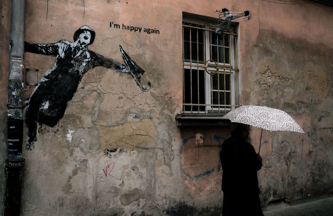 'I'm happy again' Architecture Art Is Everywhere Building Exterior Built Structure Graffiti Graffiti Art Graffiti Wall Hapiness Krakow Moments One Person Outdoors Philosophy Poland Rain Real People Street Photography Streetphotography Umbrella Wall The Street Photographer - 2017 EyeEm Awards