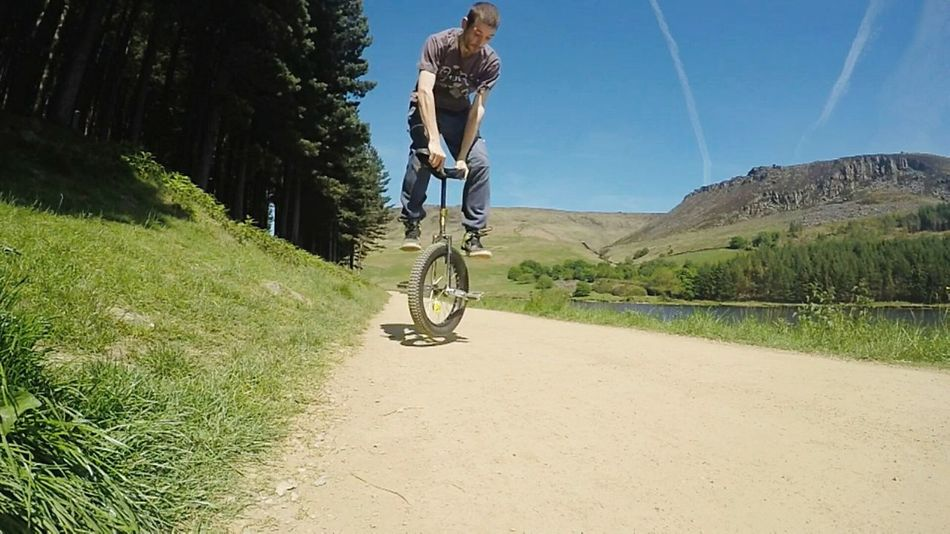 Doing tricks at dovestones reservoir Unicycle Unicycle Tricks Sports Extreme Unicycling Extreme Sports DoveStones Reservoir On Your Bike Celebrate Your Ride Alternative Fitness Sunlight Motion The Great Outdoors With Adobe