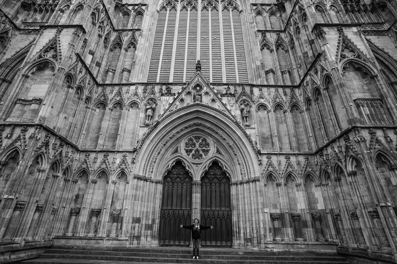 A tourist poses infront of the famous Yorkminister church. York, UK. Arch Architecture Building Exterior Built Structure Day Façade History Low Angle View Outdoors Place Of Worship Pose Real People Religion Spirituality Tourist Travel Destinations