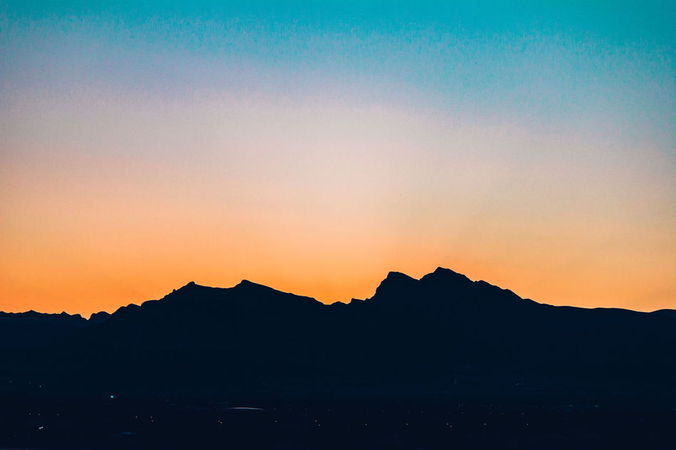 Beauty In Nature Dramatic Sky Mountain Mountain Range Nature No People Orange Color Outdoors Scenics Silhouette Sky Sunset Tranquil Scene Tranquility