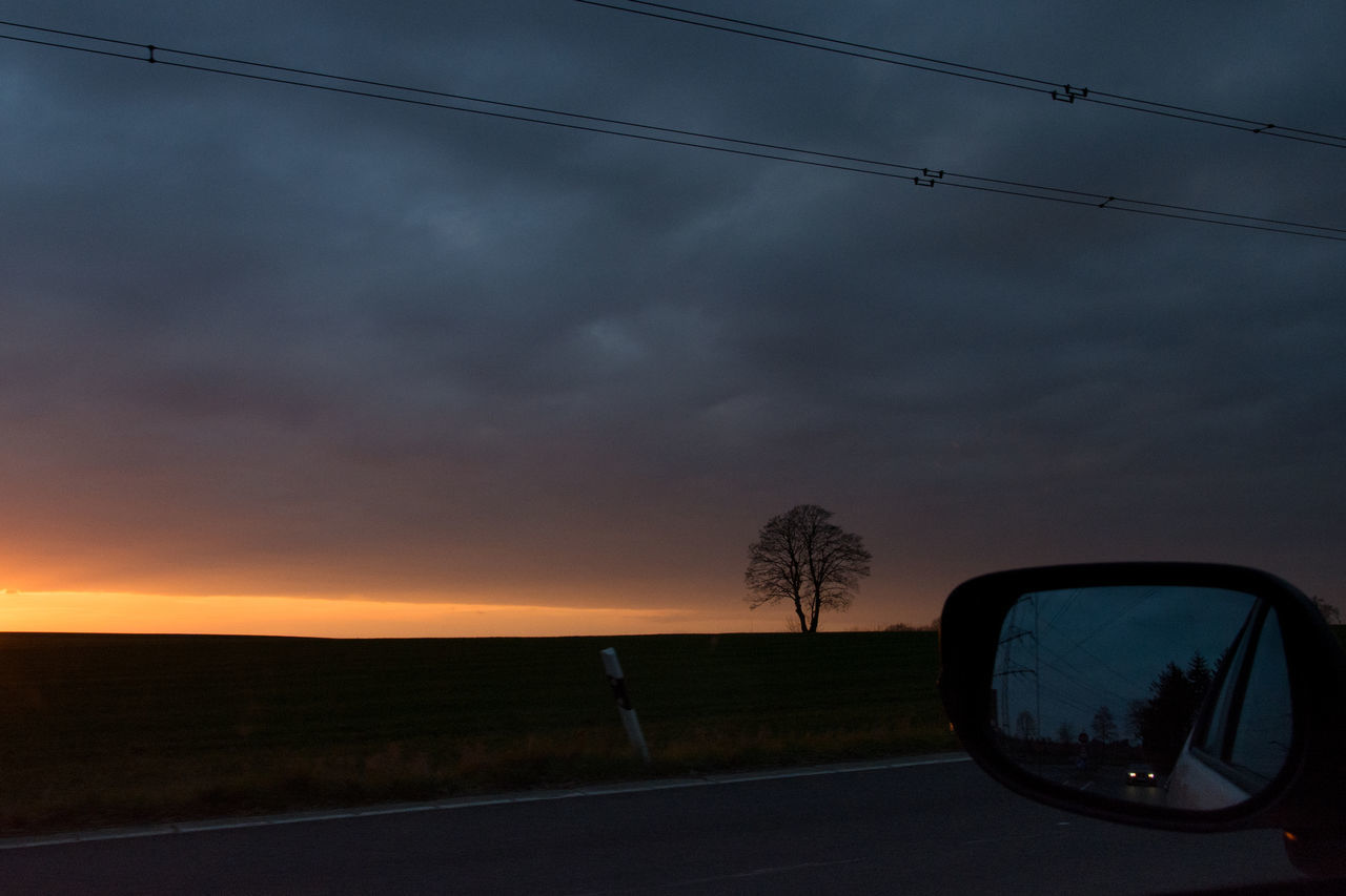 sunset, sky, cloud - sky, car, dramatic sky, tree, road, nature, scenics, transportation, storm cloud, silhouette, beauty in nature, outdoors, no people, day