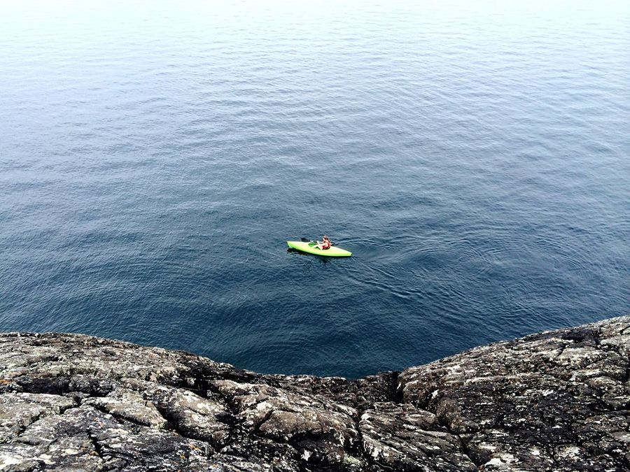 Watching a kayaker go back while hiking around the black rocks of Presque Isle, Michigan. Michigan Upperpeninsula Puremichigan Check This Out Hello World Taking Photos Enjoying Life On The Road TheGreatOutdoors Hiking